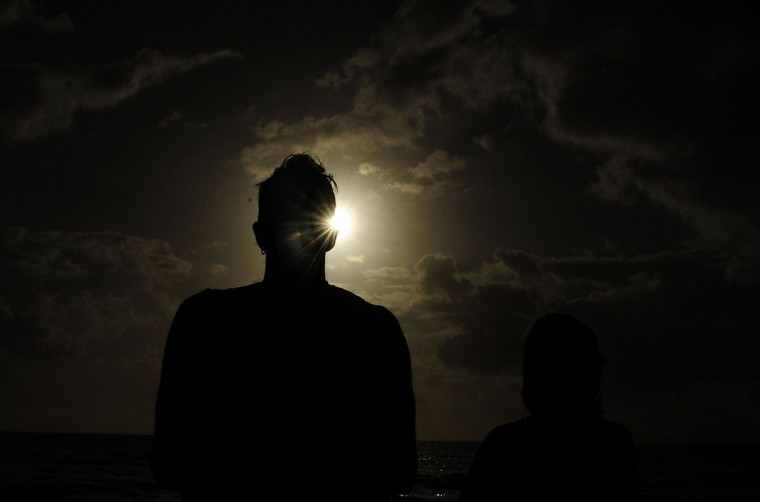 A spectator views the solar eclipse on November 14, 2012 in Palm Cove, Australia. (Ian Hitchcock/Getty Images)