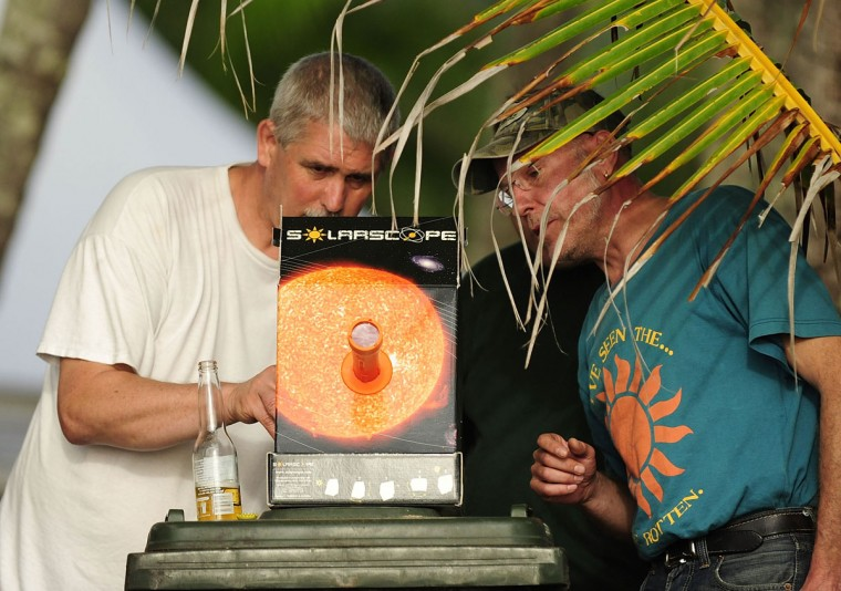 Spectators use an eclipse viewer to watch the total solar eclipse on November 14, 2012 in Palm Cove, Australia. (Ian Hitchcock/Getty Images)
