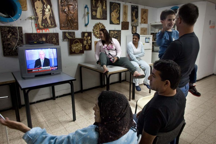 NOVEMBER 14 — Israelis watch Israeli PM Benjamin Netanyahu on TV in a bomb shelter on November 14, 2012 in Netivot, Israel. Israel Defense Forces launched aerial attacks on targets in Gaza that killed the top military commander of Hamas, (Uriel Sinai/Getty Images)