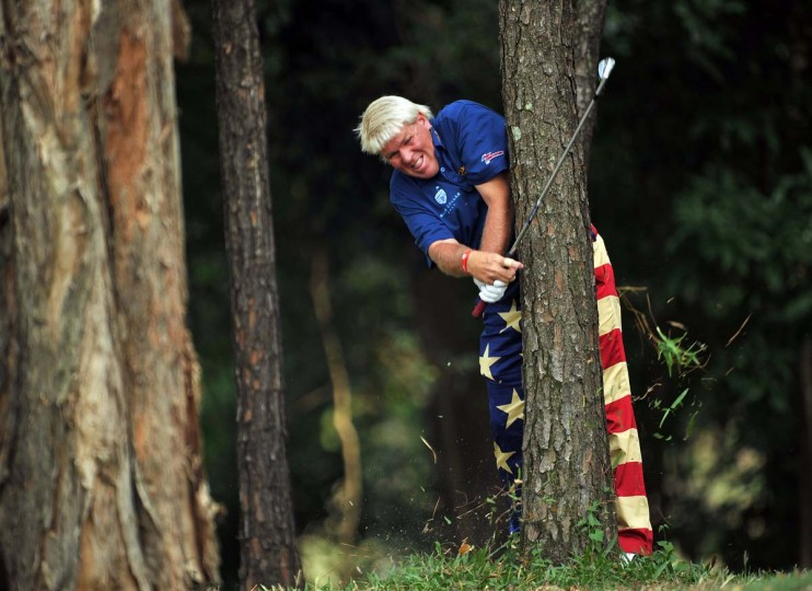 John Daly of USA plays a shot from the trees during the first round of the UBS Hong Kong open at The Hong Kong Golf Club in Hong Kong, Hong Kong. (Stuart Franklin/Getty Images)