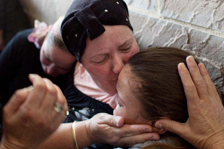 NOVEMBER 16 — Relatives grieve at the funeral for Itzik Amsalem, 49, one of the three people who died in a rocket attack on November 16, 2012 in Kiryat Malachi, Israel. (Uriel Sinai/Getty Images)
