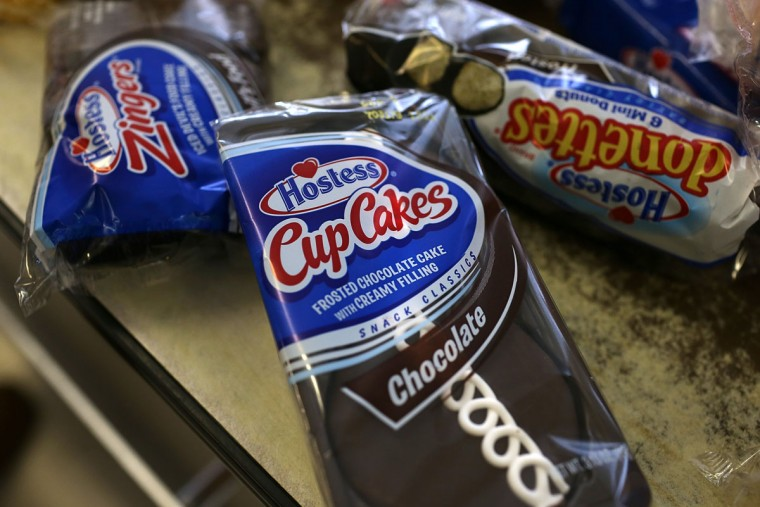Packages of Hostess products sit on a counter at a Wonder Hostess Bakery Outlet in San Leandro, California. Customers raced to the stores to stock up on Twinkies, Ding Dongs and more after Hostess Brands announced plans to liquidate its assets and lay off nearly 18,500 employees. (Justin Sullivan/Getty Images)