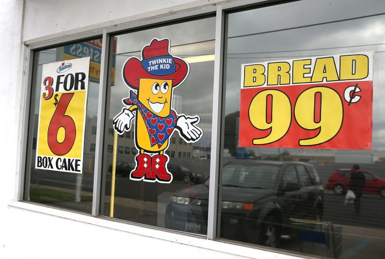 A Twinkie the Kid sign is posted on the window at a Wonder Hostess Bakery Outlet in San Leandro, California. Hostess Brands, the maker of Twinkies, Ding Dongs and Wonder Bread, announced plans to liquidate its assets, leading some shoppers to stock up on the company's products. (Justin Sullivan/Getty Images)