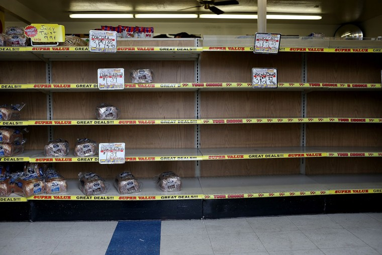 A shelf sits mostly empty at a Wonder Hostess Bakery Outlet in San Leandro, Calif. Hostess Brands, the maker of Twinkies, Ding Dongs and Wonder Bread, announced plans to liquidate its assets and lay off nearly 18,500 employees. The news prompted some concerned shoppers to stock up on the company's products. (Justin Sullivan/Getty Images)