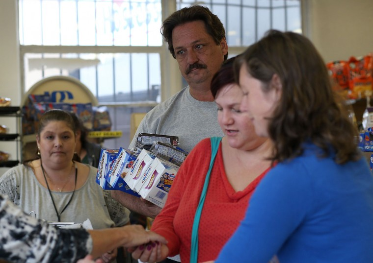 People line up to purchase packages of Hostess products at a Wonder Hostess Bakery Outlet in San Leandro, Calif. After Hostess Brands announced plans to liquidate its assets and close for business, some concerned shoppers tried to stock up on the company's iconic snack foods, including Twinkies, Wonder Bead and Ho Hos.(Justin Sullivan/Getty Images)