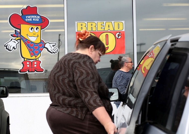 A customer leaves a Wonder Hostess Bakery Outlet on Nov. 16, 2012 in San Leandro, Calif. Hostess Brands, the maker of Twinkies, Ding Dongs and Wonder Bread, announced plans to liquidate its assets, leading some concerned shoppers to stock up on the company's iconic products. (Justin Sullivan/Getty Images)