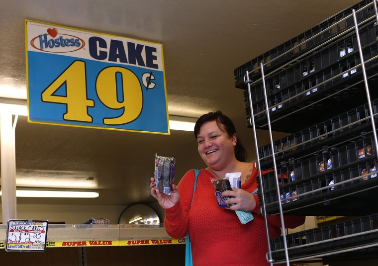 A customer shops for Hostess products at a Wonder Hostess Bakery Outlet in San Leandro, Calif. Hostess Brands, the maker of Twinkies, Ding Dongs and Wonder Bread, announced plans to liquidate its assets, prompting some concerned shoppers to stock up on the company's products. (Justin Sullivan/Getty Images)