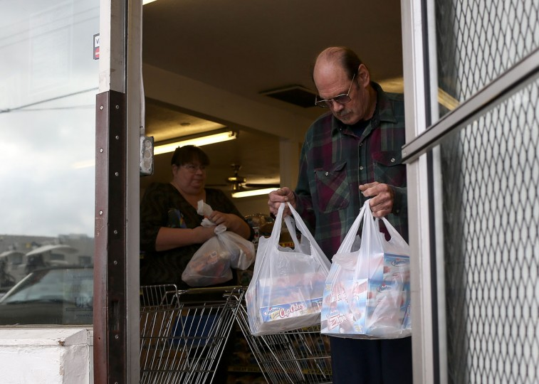 Customers carry bags of Hostess products as they leave a Wonder Hostess Bakery Outlet in San Leandro, California. Hostess Brands, the maker of Twinkies, Ding Dongs and Wonder Bread, announced plans to liquidate its assets, prompting some concerned shoppers to stock up on the company's products. (Justin Sullivan/Getty Images)