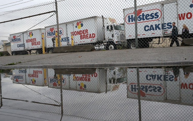 Trucks sit idle at the Hostess baking facility in Oakland, California. Hostess Brands, the maker of Twinkies, Ding Dongs and Wonder Bread, announced plans to liquidate its assets and lay off nearly 18,500 employees due to a workers' strike brought on by an imposed contract that would cut wages by 8 percent. (Justin Sullivan/Getty Images)