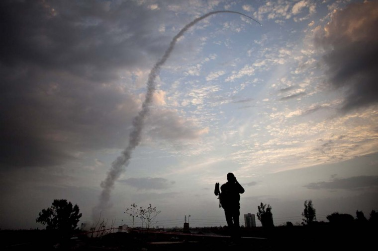 NOVEMBER 17 — An Israeli missile from the Iron Dome defense missile system is launched to intercept and destroy incoming rocket fire from Gaza on November 17, 2012 in Tel Aviv, Israel. Israeli troops have been massing on the border as some 200 targets were hit overnight in Gaza, including Hamas cabinet buildings. (Uriel Sinai/Getty Images)