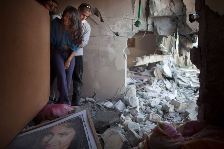 NOVEMBER 20: Sapir Hachmon and her boyfriend Ron Vachnish react as they enter her room after it was hit by a rocket fired from the Gaza Strip in Beersheba, Israel. (Uriel Sinai/Getty Images)