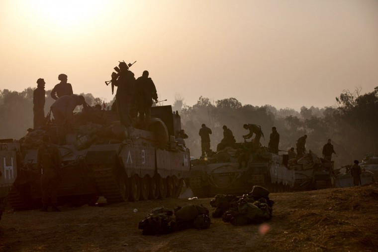 NOVEMBER 20: Israeli soldiers prepare weapons and vehicles in a deployment area as the conflict between Palestine and Gaza enters its seventh day on Israel's border with the Gaza Strip. (Uriel Sinai/Getty Images)