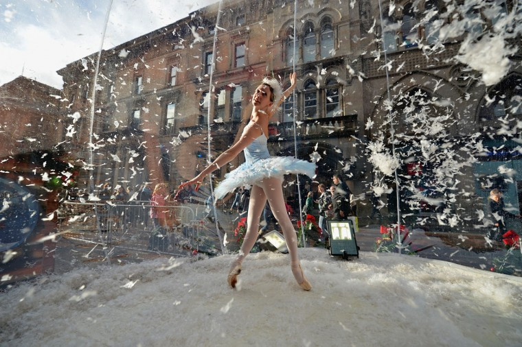 Claire Robertson from Scottish Ballet, poses dressed as the Good Snow Flake inside a life size snow globe on Buchanan Street during a promotion for Scottish Ballet's festive production of The Nutcracker in Glasgow, Scotland. The Nutcracker opens at the Theatre Royal on December the 8th, the production delves deep into the darker reaches of Hoffmann's original tale in a fresh and vivid retelling of the famous Christmas story. (Jeff J Mitchell/Getty Images)