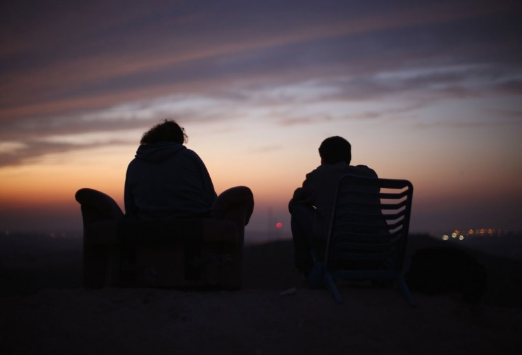 NOVEMBER 21: Israelis sit on a hill top and watch the bombardment of Gaza by Israeli forces on Israel's border with the Gaza Strip. (Christopher Furlong/Getty Images)