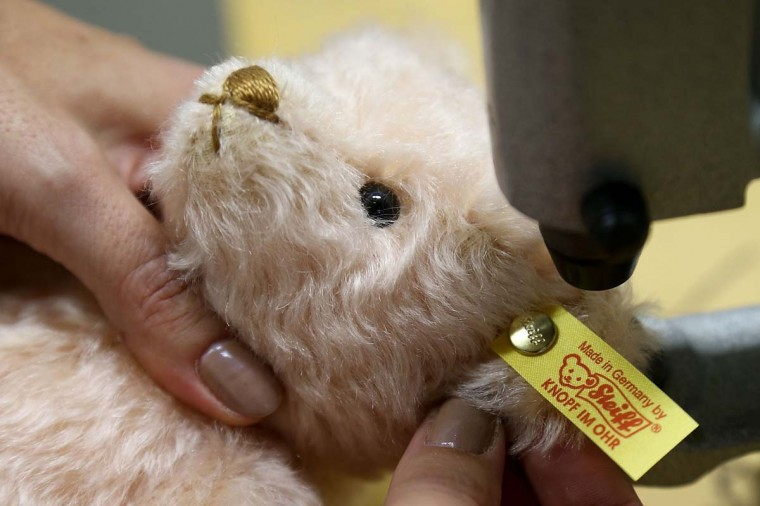 A teddy bear has the company logo pinned to its ear at the Steiff stuffed toy factory on November 23, 2012 in Giengen an der Brenz, Germany. Founded by seamstress Margarethe Steiff in 1880, Steiff has been making stuffed teddy bears since the early 20th century ever since her nephew Richard Steiff exhibited the first commercially produced teddy bear in Europe in 1903. (Thomas Niedermueller/Getty Images)