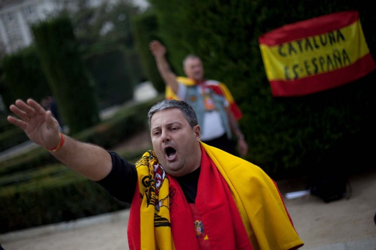 Supporters of former Spanish dictator General Francisco Franco give fascist salutes during a rally commemorating the 37nd anniversary of Spanish dictator General Francisco Franco's death at Plaza de Oriente on November 25, 2012 in Madrid, Spain. (Pablo Blazquez Dominguez/Getty Images)