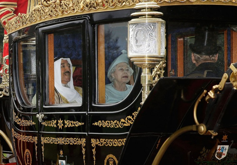 His Highness the Amir Sheikh Sabah Al-Ahmad Al-Jaber Al-Sabah of Kuwait accompanies Queen Elizabeth II in a ceremonial procession into the grounds of Windsor Castle during his three-day state visit in Windsor, England. (Matthew Lloyd/Getty Images)
