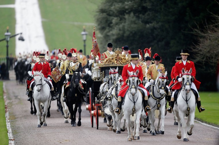 A ceremonial procession carrying His Highness the Amir Sheikh Sabah Al-Ahmad Al-Jaber Al-Sabah of Kuwait and Queen Elizabeth II arrives in the grounds of Windsor Castle during a three-day state visit in Windsor, England. In the afternoon a military parade will be inspected at Royal Military Academy Sandhurst then a banquet is to be held at Windsor Castle in the Amir's honour this evening. (Matthew Lloyd/Getty Images)