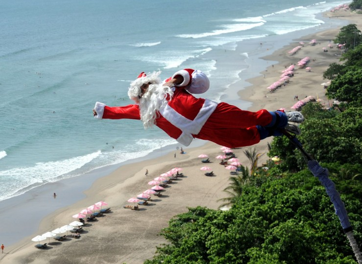 A bungee jumper dressed as Santa Claus leaps from a platform above Kuta beach, Denpasar on Indonesia's resort island of Bali on December 2, 2011. (Sonny Tumbelaka/AFP/Getty Images) ORG XMIT:
