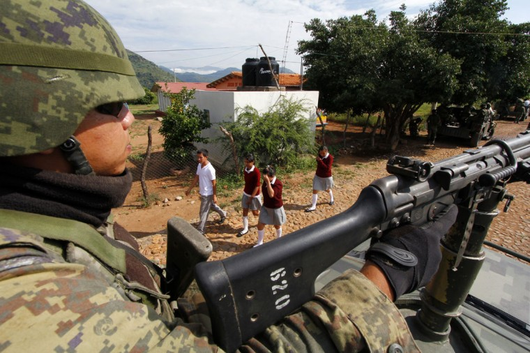 September 27, 2012: A Mexican soldier patrols the border area between the states of Jalisco and Nayarit in search of illegal fields of marijuana in Magdalena, Jalisco State, Mexico. (Hector Guerrero/AFP/Getty Images)