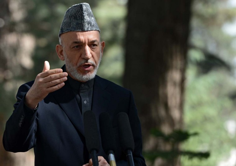 """Reuters — Afghan President Hamid Karzai said he hoped Obama's re-election would allow U.S.-Afghan ties to further expand even as the United States plans to withdraw most combat troops by the end of 2014. """"American is a strong ally of Afghanistan and we congratulate Obama's victory as a new U.S. president. We hope he puts more effort in fighting against terrorists and their bases in Pakistan,"""" said Karzai spokesman Siamak Herawi. (Massoud Hossaini/AFP/Getty Images)"""