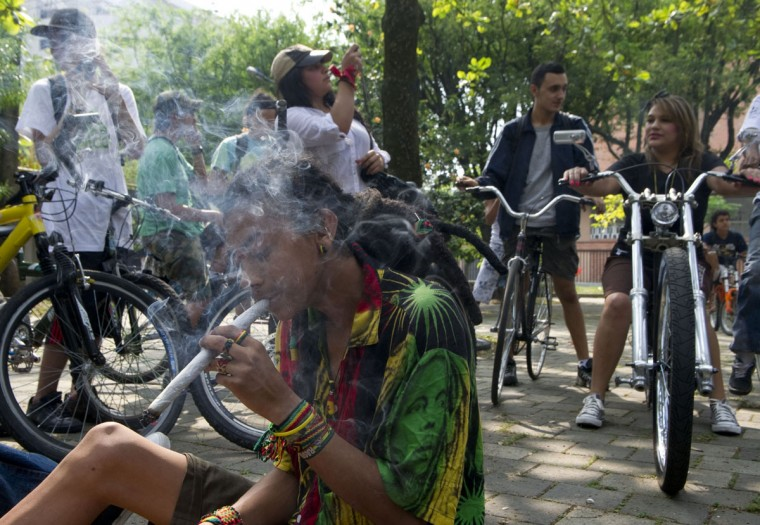 October 6, 2012: A man smokes marijuana during the first world bicycle ride against drug trafficking and in favour of the legalization of self-cultivation of marijuana for medicinal and recreational purposes in Medellin, Antioquia department, Colombia. (Raul Arboleda/AFP/Getty Images)