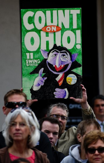 A supporter of US Republican presidential candidate Mitt Romney holds up a placard with Sesame Street character Count Von Count outside Buns Bakery and Restaurant in Delaware, Ohio. (Jim Watson/AFP/Getty Images)