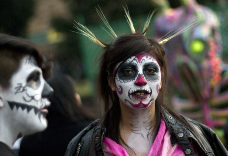 Mexican students at the National Autonomous University of Mexico (UNAM) in Mexico City on October 30, 2012, during preparations on the eve of the Day of the Dead celebrations. Tradition includes building altars honouring their deceased relatives and this year, the UNAM dedicated it to Mexico's indigenous peoples. (Pedro Pardo/AFP/Getty Images)