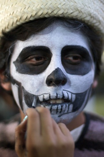 Mexican students at the National Autonomous University of Mexico (UNAM) in Mexico City on October 30, 2012, during preparations on the eve of the Day of the Dead celebrations. (Pedro Pardo/AFP/Getty Images)