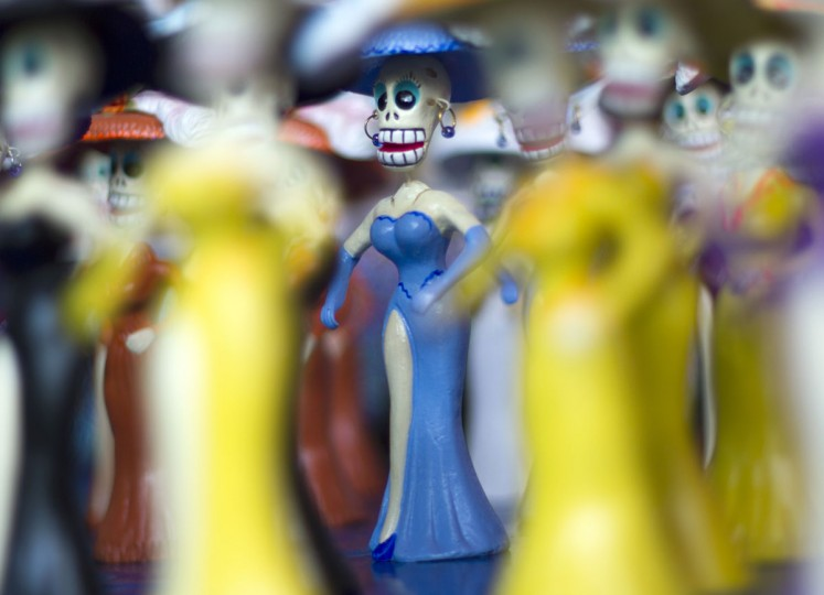 Small skeleton figures are displayed at the Jamaica market in Mexico City, on October 31, 2012, as Mexicans prepare to celebrate the traditional Day of the Dead. (Pedro Pardo/AFP/Getty Images)