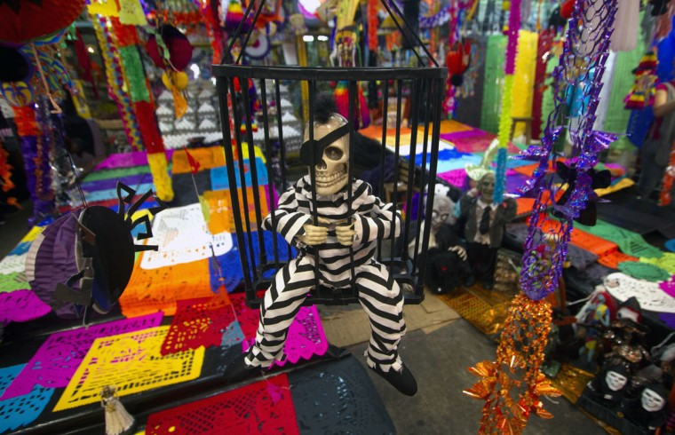 A skeleton figure is displayed at the Jamaica market in Mexico City, on October 31, 2012, as Mexicans prepare to celebrate the traditional Day of the Dead. (Pedro Pardo/AFP/Getty Images)