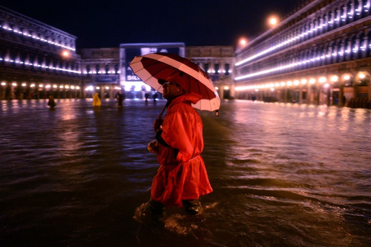 "A man walks on the flooded Saint Mark's Square during ""acqua alta"" flooding on October 31, 2012, in Venice. (Olivier Morin/AFP/Getty Images)"