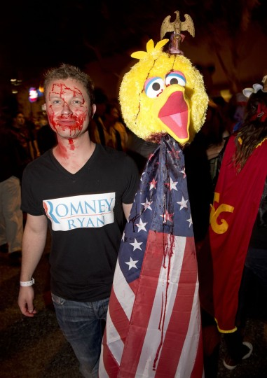 "Steven Lauridsen spoofs comments made by U.S. presidential candidate Mitt Romney regarding the ""Sesame Street"" character Big Bird as he parades on Santa Monica Blvd. during annual Halloween Carnaval in West Hollywood, California. (Robyn Beck/AFP Photo)"