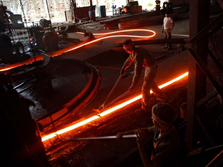 Indian laborers work at a steel factory in the outskirts of Agartala, India's northeastern state of Tripura. India's prime minister on November 1 urged his re-shuffled administration to focus all its efforts on reviving the flagging economy, and said pushing through infrastructure projects would be prioritised. (Getty Images)