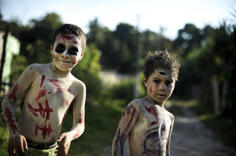 Young revelers get ready to take part in a parade called 'La Calabiuza' on November 1, 2012, on the eve of the Day of the Dead in Tonacatepeque, 20 kms (13 miles) north of San Salvador. (Jose Cabezas/AFP/Getty Images)