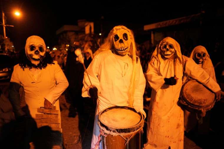 Young revelers take part in a parade called 'La Calabiuza' on November 1, 2012, on the eve of the Day of the Dead in Tonacatepeque, 20 kms (13 miles) north of San Salvador. (Jose Cabezas/AFP/Getty Images)