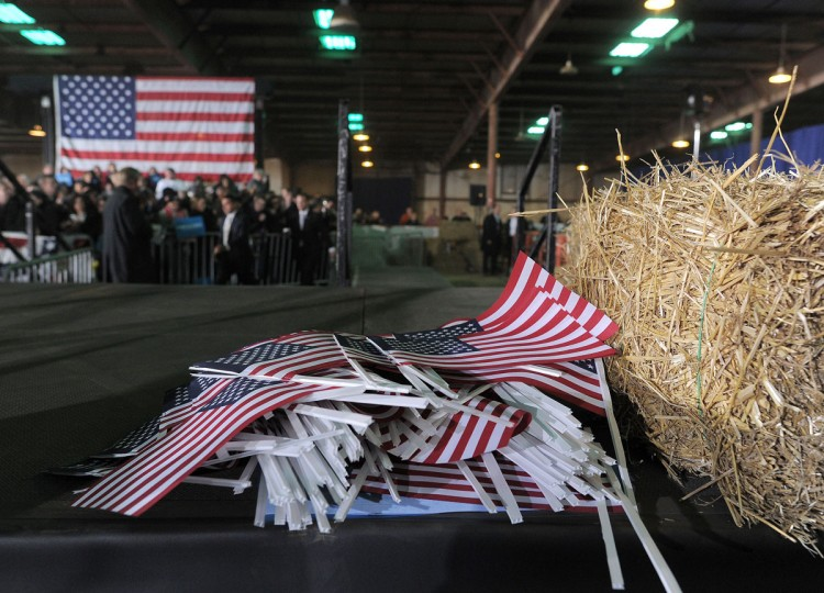 U.S. flags are seen piled up on the stage before U.S. President Barack Obama speaks during a campaign rally at the Franklin County Fairgrounds in Hilliard, Ohio, on November 2, 2012. (Jewel Samad/AFP/Getty Images)