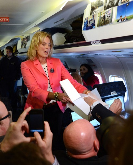 Ann Romney, wife of U.S. Republican Presidential candidate Mitt Romney, offers pastries to journalists aboard Romney's campaign plane at Portsmouth International Airport in Newington, New Hampshire. (Emmanuel Dunand/AFP/Getty Images)
