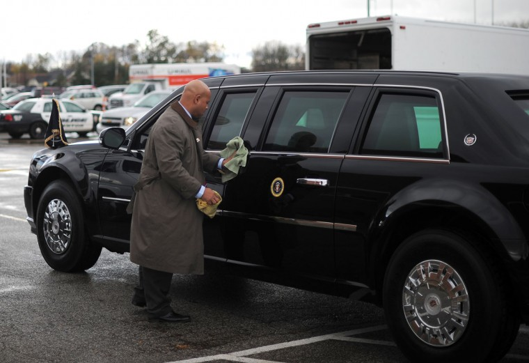 A U.S. Secret Service member polishes the limousine of U.S. President Barack Obama before a campaign rally at Mentor High School in Mentor, Ohio, on November 3, 2012. (Jewel Samad/AFP/Getty Images)