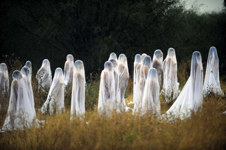 Naked volunteers perform for U.S. photographer and artist Spencer Tunick (out of frame) at Los Senderos Villages in San Miguel de Allende municipality, Guanajuato State, Mexico on November 4, 2012. Tunick is in Mexico for one day to make this performance commemorating the Day of the Dead. (Alfredo Estrella/AFP/Getty Images)