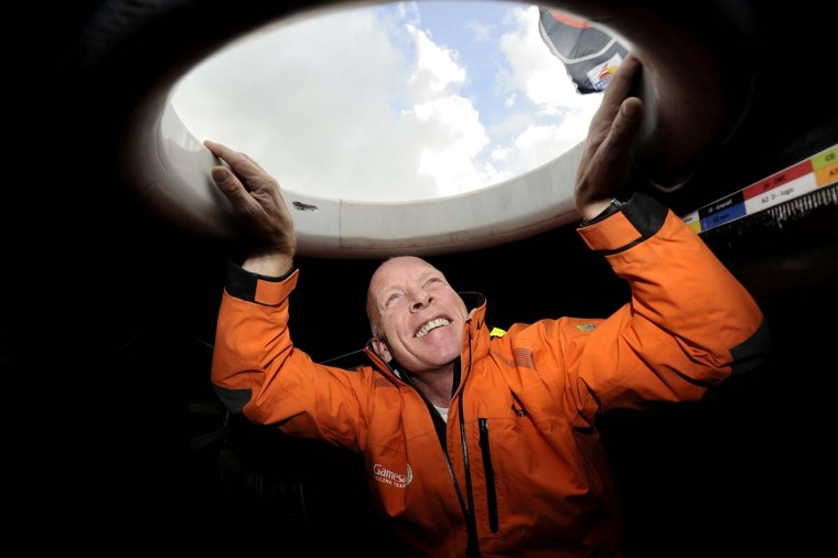 "English skipper Mike Golding poses aboard his monohull ""Gamesa"" on November 5, 2012 in Les Sables-d'Olonne, western France.Golding is taking part in the 7th edition of the Vendee Globe solo round-the-world race which will start on November 10, 2012. (Jean-Sebastien Evrard/AFP/Getty Images)"