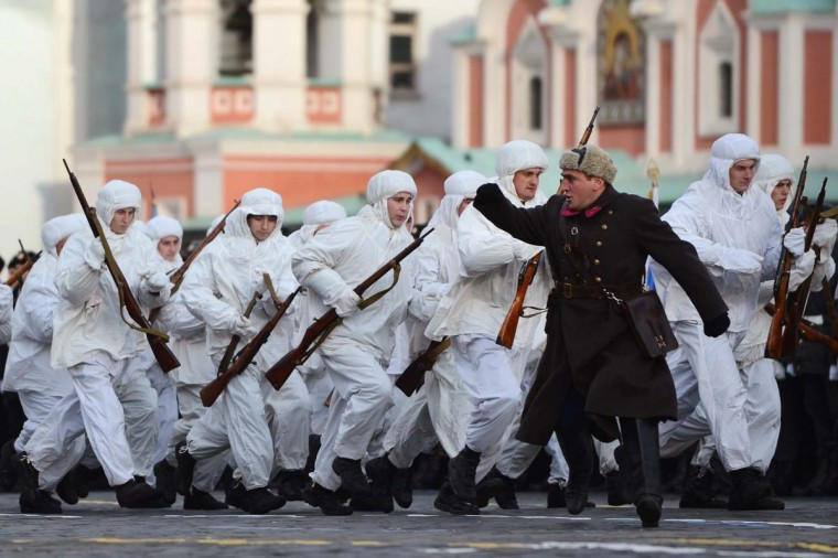 Russian soldiers wearing Soviet Union WWII military uniforms take part in a rehearsal of a military parade on the Red square in Moscow on November 5, 2012. The event will take place on November 7, marking the 71st anniversary of a historical parade of 1941, when soldiers left for a front line just after marching here, as Nazi German troops were fighting with Soviet soldiers a few kilometers from Moscow. (Natalia Kolesnikovana/AFP/Getty Images)