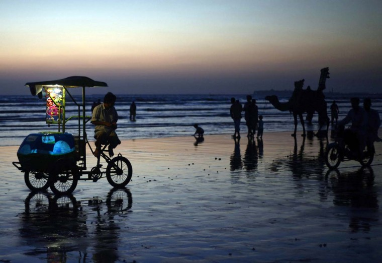 Pakistanis gather on Sea View Beach during sunset in Karachi on November 5, 2012. The beach, which overlooks the Arabian sea, is a popular attraction for families and tourists. (Asif Hassan/AFP/Getty Images)