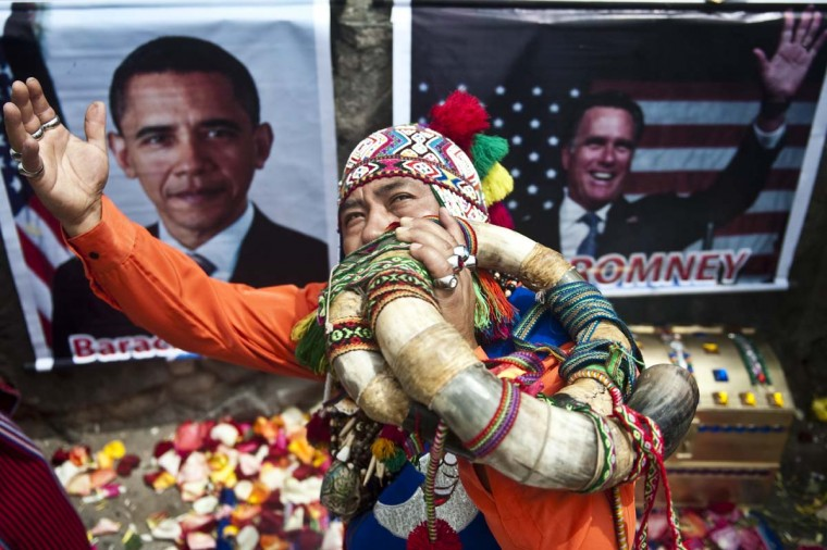 A Peruvian shaman performs rituals to predict the winner of the 2012 U.S. election, at San Cristobal hill in Lima, on November 05, 2012. The shaman prognosticated that Obama will succeed. (Ernesto Benavides/AFP/Getty Images)