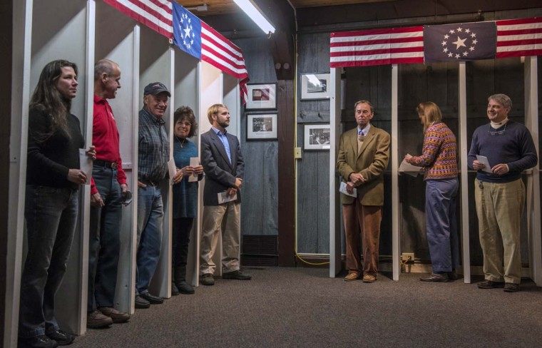 DIXVILLE NOTCH, NH: People prepare to cast their ballots inside polling booths just after midnight on November 6, 2012 in Dixville Notch, New Hampshire, the very first voting to take place in the 2012 US presidential election. The final national polls showed an effective tie, with either US President Barack Obama or Republican challenger Mitt Romney favored by a single point in most surveys, reflecting the polarized politics of a deeply divided nation. (Rogerio Barbosa/AFP/Getty Images)