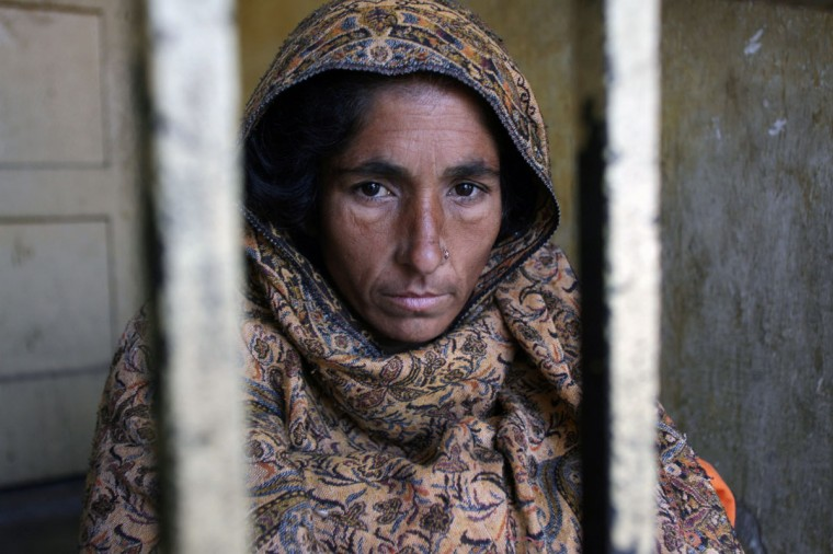 Arrested Pakistani mother Zaheen Akhtar sits in her cell at a police station in Khoi Ratta, 140 kilometres (85 miles) north of Pakistani Kashmir's main city Muzaffarabad. The parents threw acid over 15-year-old Anusha at their home in Pakistan-administered Kashmir on Monday last week after seeing her looking at boys. The girl died in agony two days later after suffering 70 percent burns, according to doctors. (Sajjad Qayyum/AFP/Getty Images)