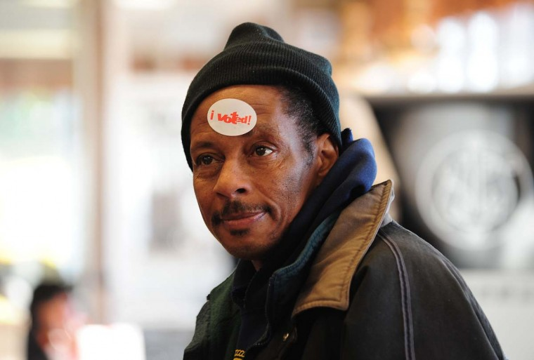 "CHICAGO, IL: Derrick Banks wears an ""I Voted"" sticker on his forehead after casting his ballot after voting in the U.S. presidential election at a polling station in Chicago, Illinois in the U.S. presidential election November 6, 2012 . The final national polls showed an effective tie, with either U.S. President Barack Obama or Republican challenger Mitt Romney favored by a single point in most surveys, reflecting the polarized politics of a deeply divided nation. (Robyn Beck/AFP/Getty Images)"