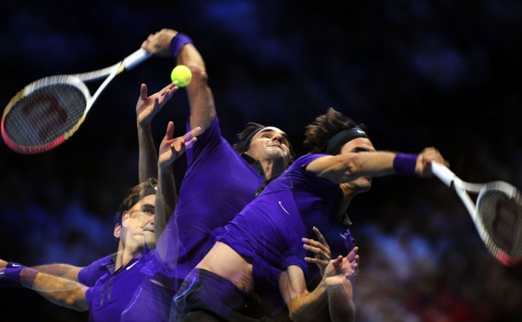 In this multiple exposure image Switzerland's Roger Federer serves against Serbia's Janko Tipsarevic during their group B singles match in the round robin stage on the second day of the ATP World Tour Finals tennis tournament in London. (Glyn Kirk/AFP/Getty Images)