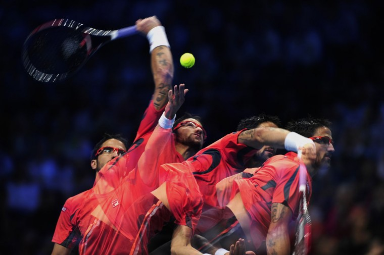 In this multiple exposure image Serbia's Janko Tipsarevic serves against Switzerland's Roger Federer during their group B singles match in the round robin stage on the second day of the ATP World Tour Finals tennis tournament in London. (Glyn Kirk/AFP/Getty Images)