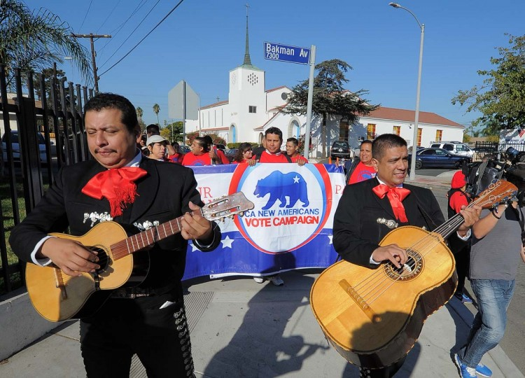 LOS ANGELES, CA: Mariachi musicians sing and play as they go from house to house to encourage people to come to vote on election day at the Sun Valley's Latino district, Los Angeles County, on November 6, 2012 in California. (Joe Klamar/AFP/Getty Images)